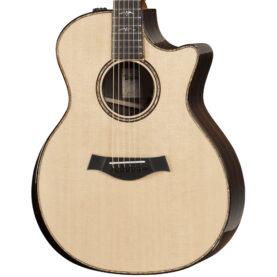 a brown guitar with a black and white design