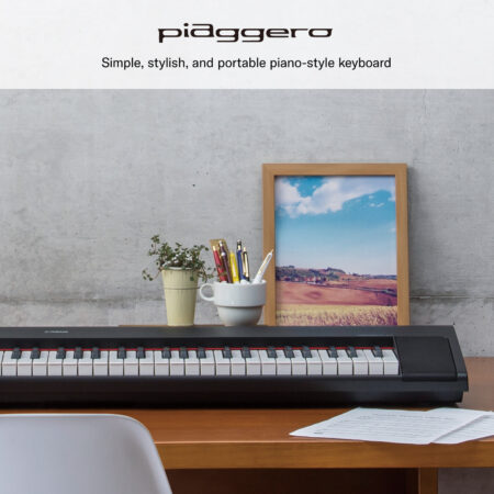 a desk with a computer and a picture on it