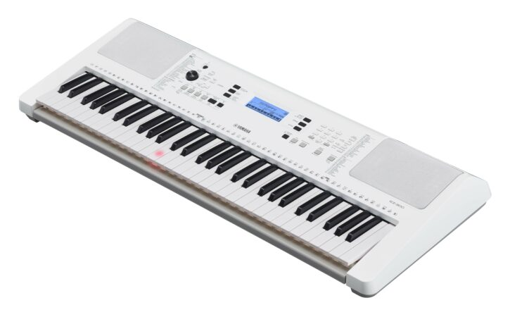 a white rectangular object with a black and white keyboard