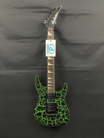 a guitar with a sign on it