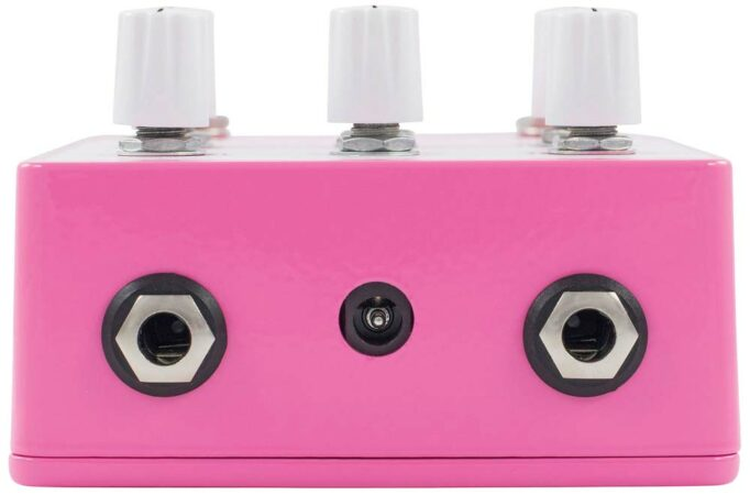 a pink and white object with buttons